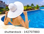 woman sitting in a swimming... | Shutterstock . vector #142707883