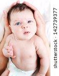 the kid in his mother's gentle... | Shutterstock . vector #142739377