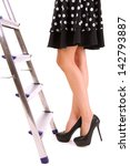 woman climbing up ladder... | Shutterstock . vector #142793887