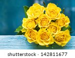Yellow roses bouquet on the...