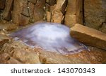 jellyfish stranded on the rocks ... | Shutterstock . vector #143070343