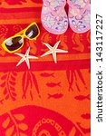 red beach towel with several... | Shutterstock . vector #143117227