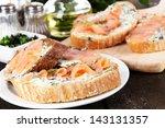 fish sandwiches on cutting...