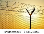 Fence Covered With Barbed Razo...