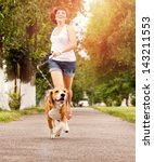 Happy Young Woman Jogging With...