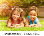 two happy kids lying down on... | Shutterstock . vector #143237113