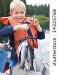 Little Boy Holding Four Trout...