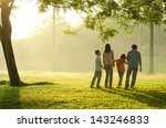 silhouette of a family walking...   Shutterstock . vector #143246833