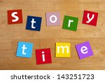 Small photo of story time - word and alphabet letters sign for stories, story books, reading, school children, libraries, teaching and education.