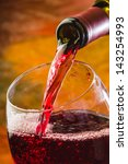 Wine Pours Into The Glass Of...