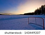 An Abandoned Hockey Net On A...