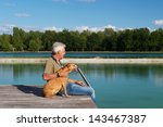 Man Sitting With Dog On Pier A...