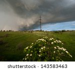 Small photo of thundercloud over of electricity transmissions to steppes, spring day