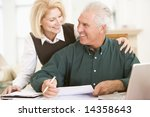 couple in dining room with... | Shutterstock . vector #14358643
