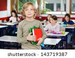 portrait of schoolboy holding...   Shutterstock . vector #143719387