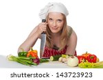 young woman chef holding knife...