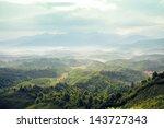 mountains under mist in the... | Shutterstock . vector #143727343