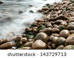 Wet Pebbles On Beach With...