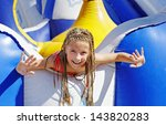 vacation. happy girl on carousel | Shutterstock . vector #143820283