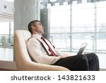 bored businessman stares out... | Shutterstock . vector #143821633