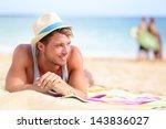 Man On Beach Lying In Sand...