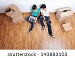 overhead view of couple sitting ... | Shutterstock . vector #143883103