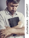 man holding a bible and praying | Shutterstock . vector #143926057