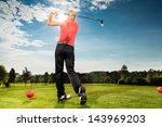 Young Female Golf Player On...