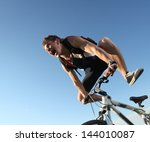 young cyclist screaming during... | Shutterstock . vector #144010087