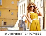 shopping woman in city | Shutterstock . vector #144074893