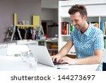 Happy Student Working On Lapto...