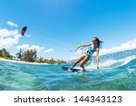kite boarding  fun in the ocean ... | Shutterstock . vector #144343123