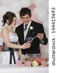 Small photo of Young man pouring punch for girlfriend at prom