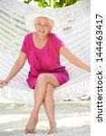 senior woman relaxing in beach... | Shutterstock . vector #144463417