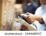 worker scanning package in... | Shutterstock . vector #144468547