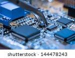 close up on tweezers holding... | Shutterstock . vector #144478243
