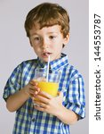 little boy with a glass of... | Shutterstock . vector #144553787