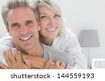 affectionate couple smiling at... | Shutterstock . vector #144559193