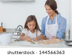 Mother And Daughter Baking...
