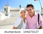 couple standing by the monument ... | Shutterstock . vector #144673127