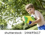 Young Shirtless Boy With Water...
