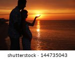 silhouette of a loving couple... | Shutterstock . vector #144735043