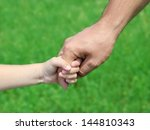 child holds the hand of the... | Shutterstock . vector #144810343