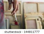 Closeup Of An Artist Holding...