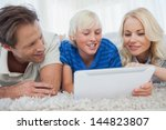 son and his parents using a... | Shutterstock . vector #144823807