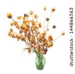 Dried Flowers In A Vase On A...