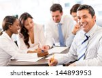 happy business man in a meeting ... | Shutterstock . vector #144893953