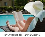 Girl In A Summer Hat Reading A...