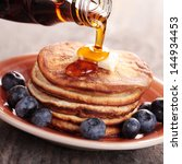 close up of pouring maple syrup ... | Shutterstock . vector #144934453