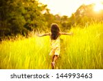 little girl running on meadow... | Shutterstock . vector #144993463